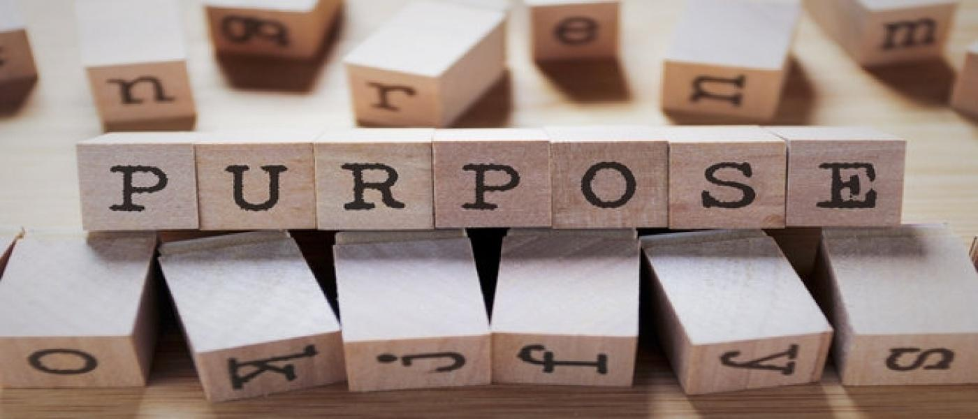 The word 'Purpose' spelt with lettered blocks
