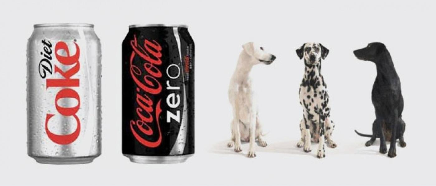 Can of diet Coke, can of Coke Zero and three dogs - one white, one spotted and one black
