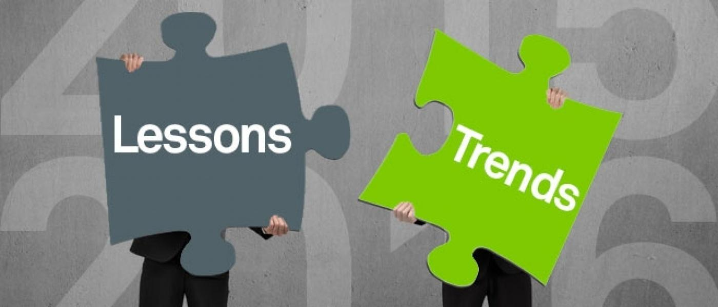 Two puzzle pieces showing the words 'lessons' and 'trends'